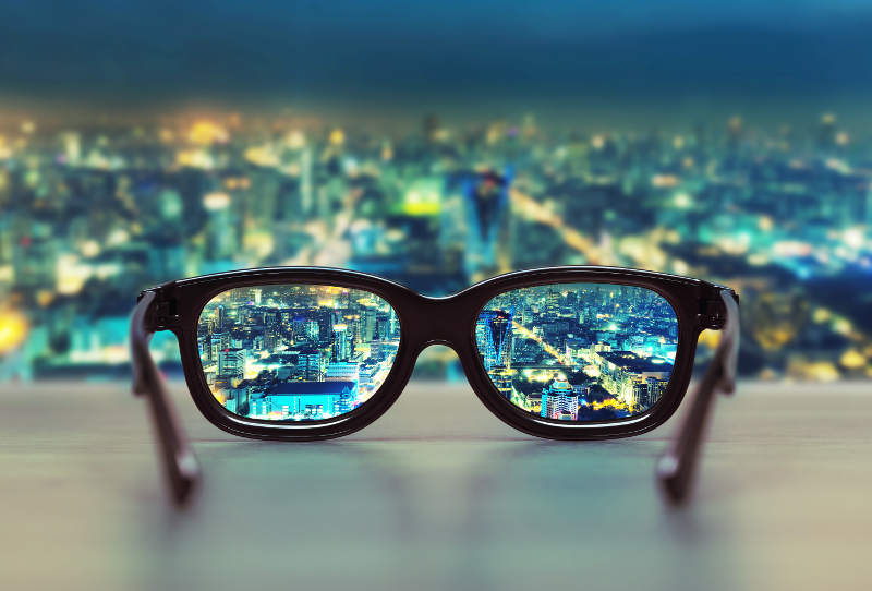 glasses overlooking night city